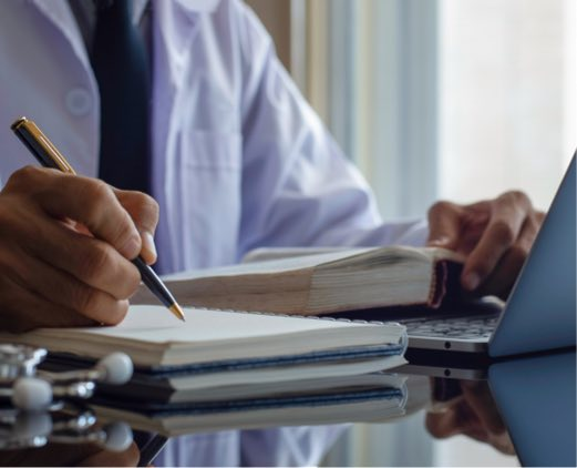 Medical Doctor Working on Documents