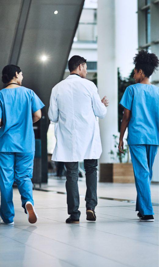 Nurse and Doctors Walking